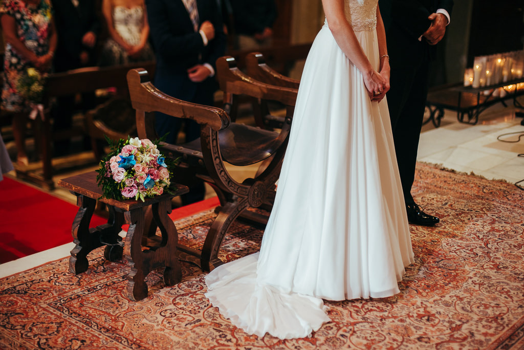 beautiful shot of the bride an groom dresses in church costa brava