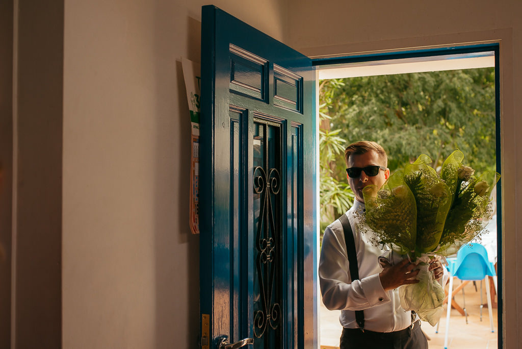 groom with wedding boquete