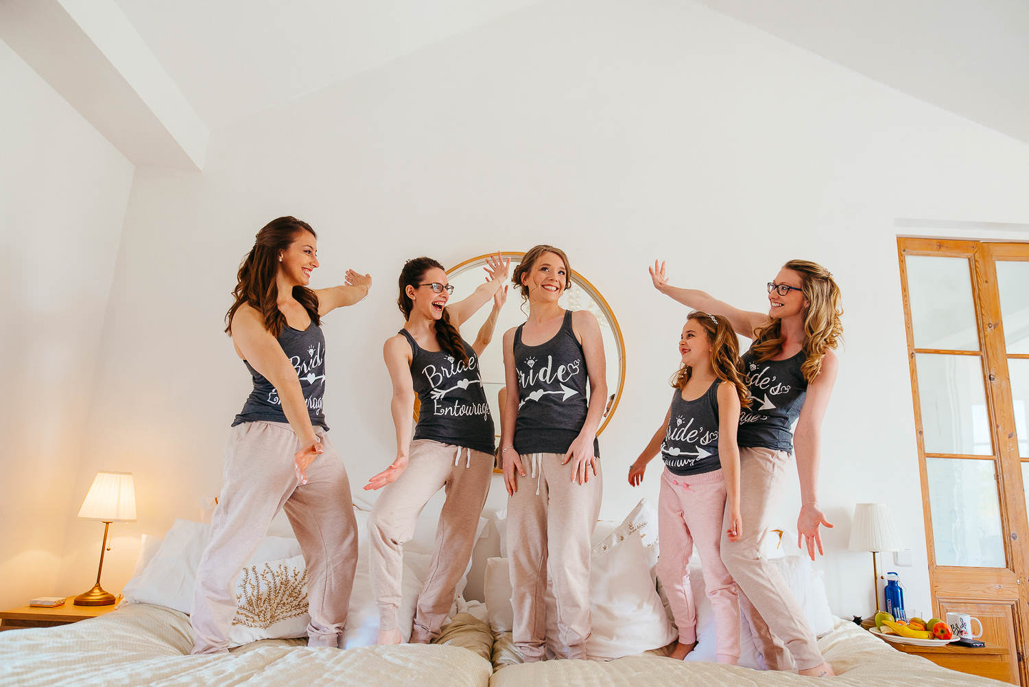 bride's maids helping bride with pre-ceremony preparations documentary wedding photography sitges