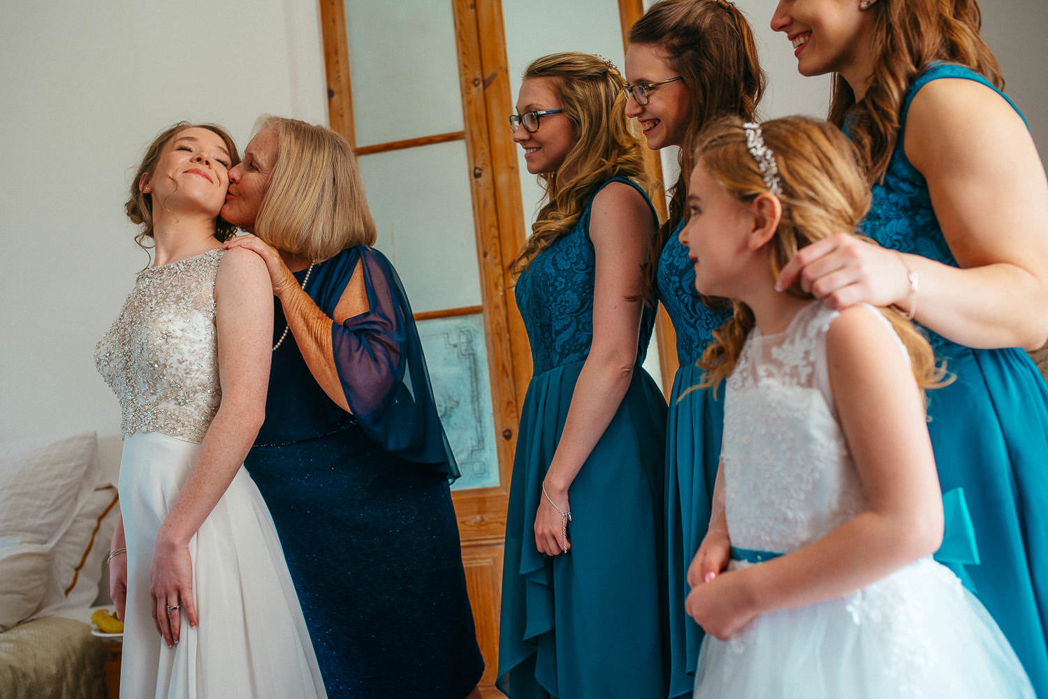 mum kissing the bride before the wedding sitges