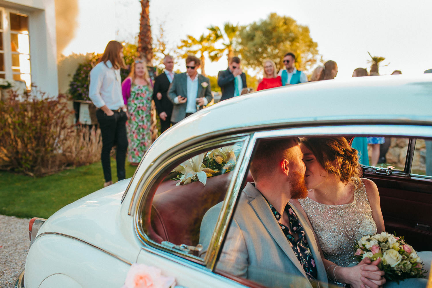 bride and groom kissing in the car wedding sitges