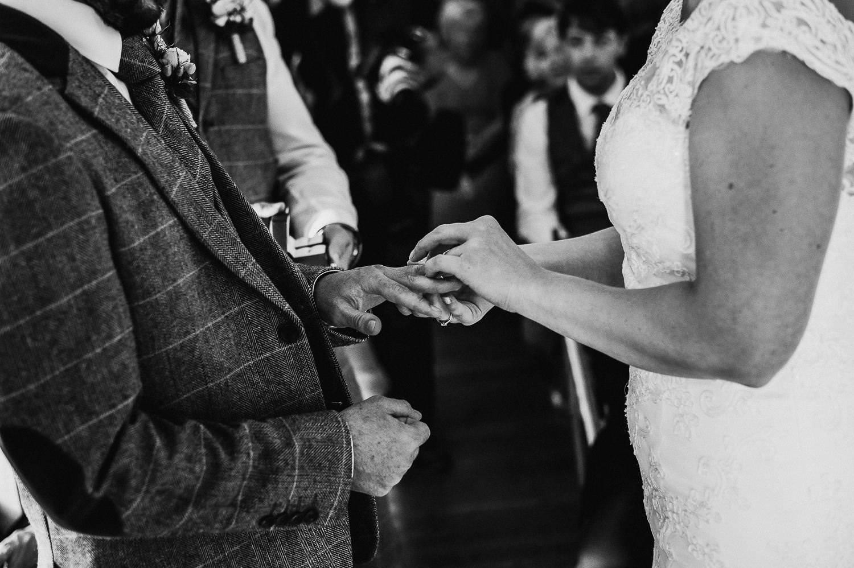 exchanging the wedding rings wedding photography costa brava faro de tossa