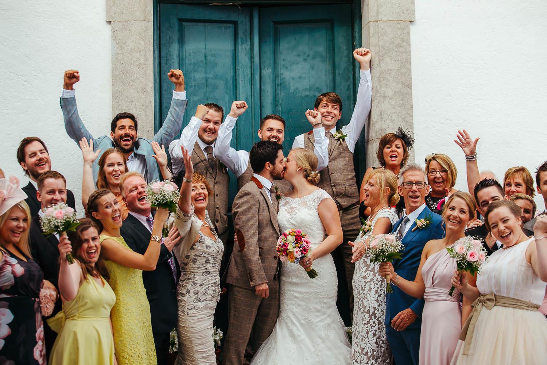 beautiful wedding group shot faro de tossa de mar