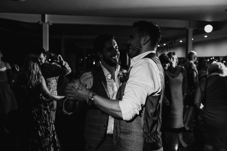 groom dancing with the groomsmen wedding tossa de mar