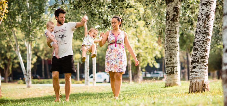 the family in the park during theirs photo session