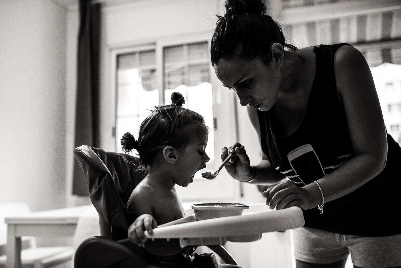mum feeds her daughter