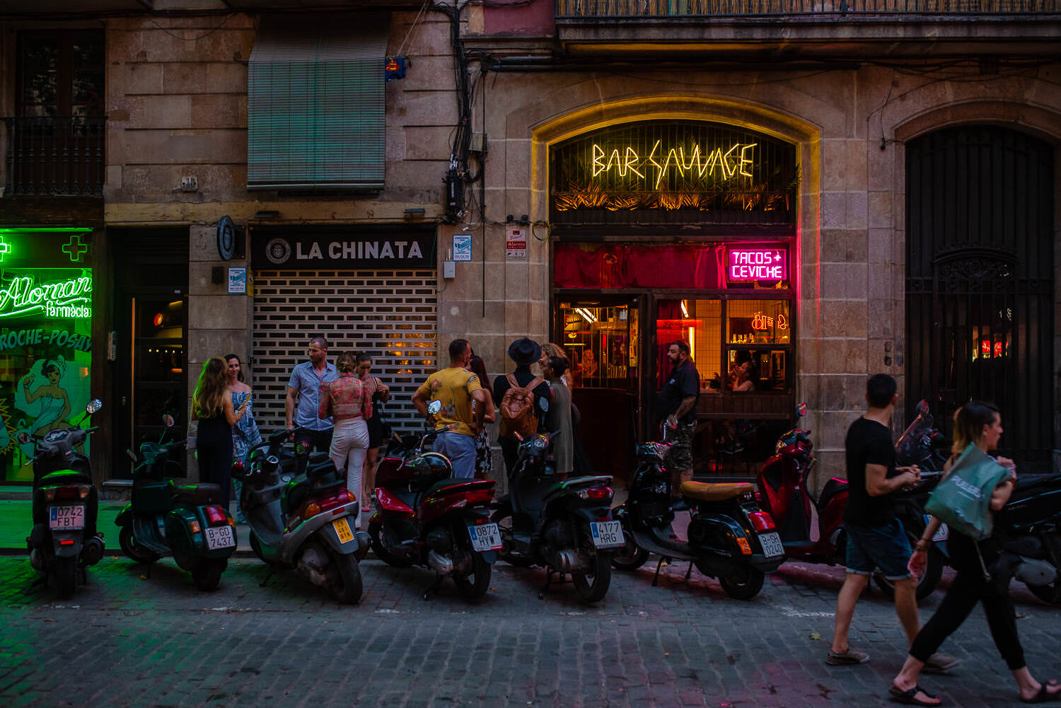 Wedding guests are waiting to enter the bar for a rehearsal party in Bar Sauvage in Barcelona