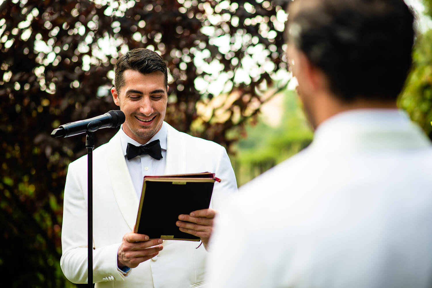 vows during gas wedding ceremony at Biblioteca Almirall