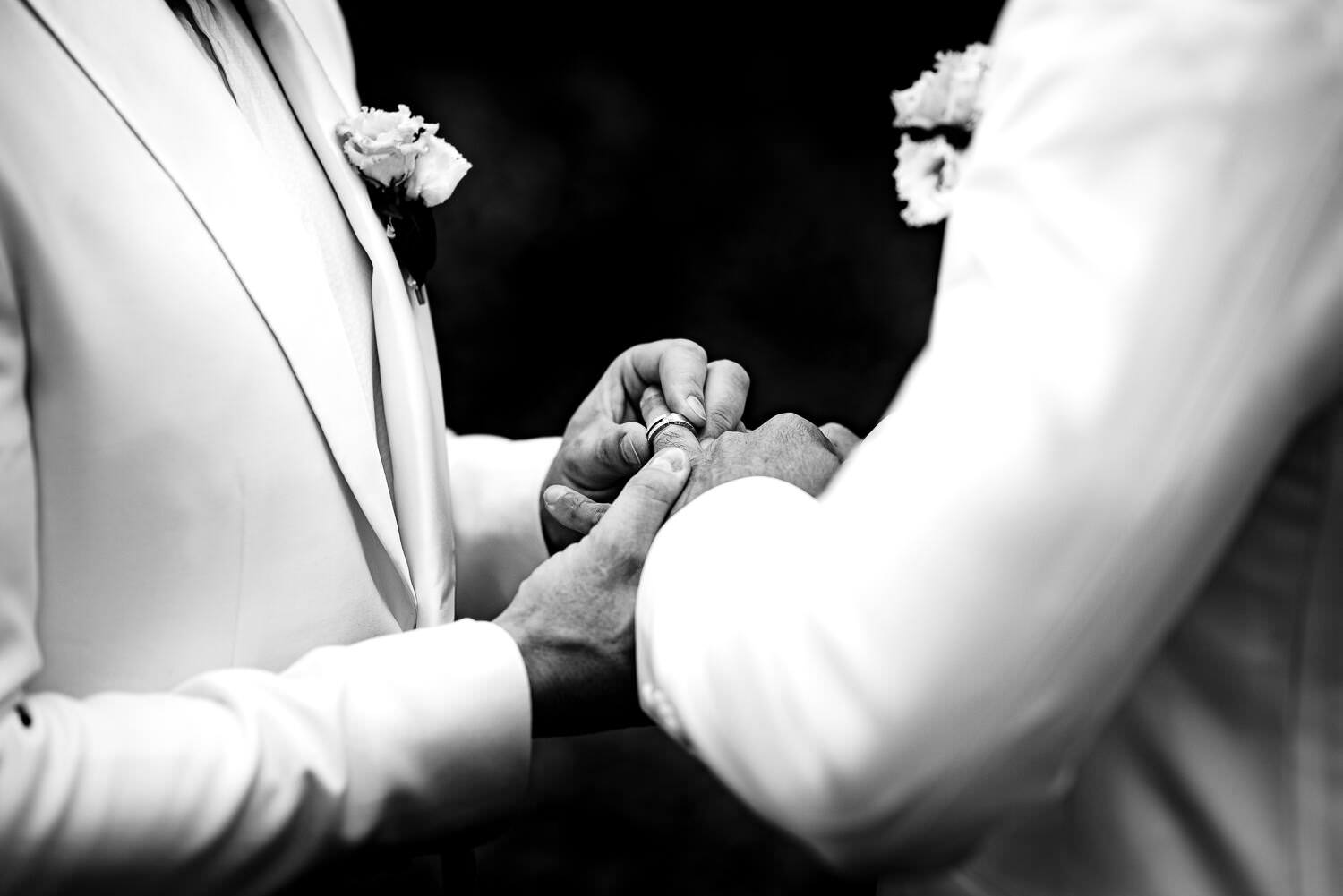 grooms exchanging rings during gay wedding ceremony at Biblioteca Almirall in Barcelona