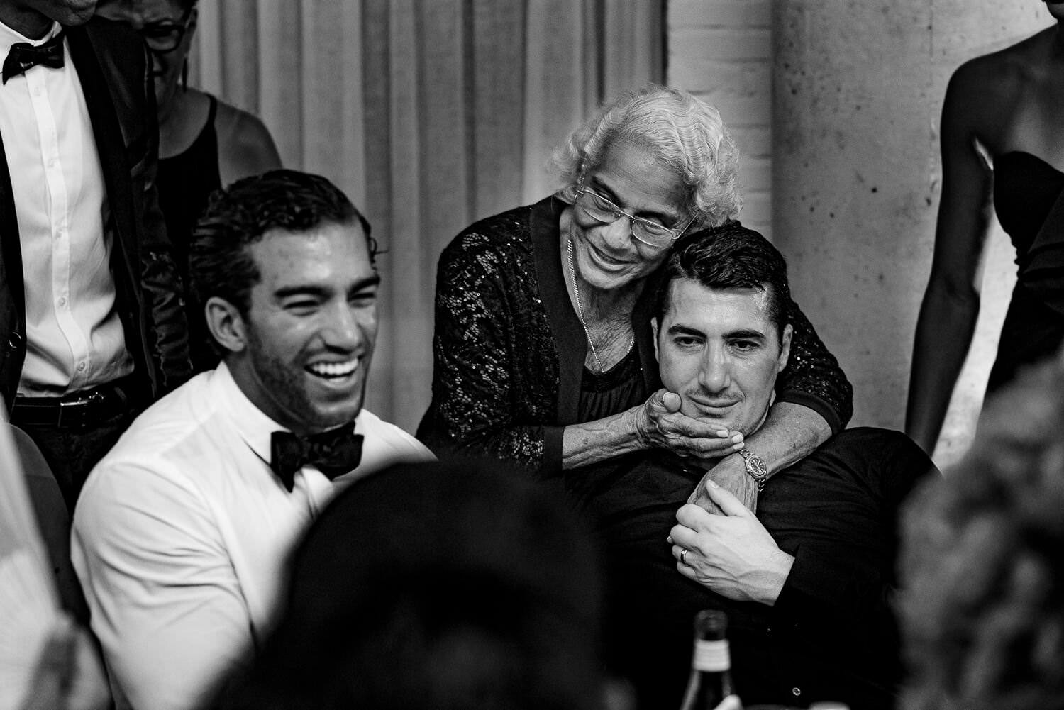 Grandma hugging the groom at dinner party at Soho House Barcelona